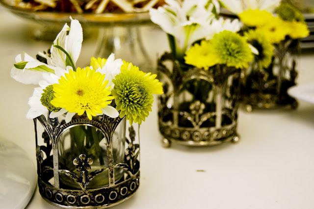 mini vase idea  using votive candle holders- The Style Sisters