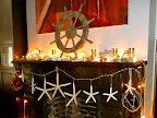 The mantle, decorated with everything nautical I could find! Ships wheel and fishing floats from Save-on-Crafts.com.