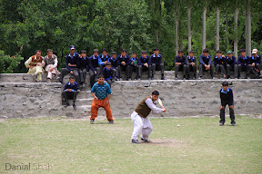 Locals of Shighar valley playing cricket in the polo ground. The ground is primarily used to play the ancient game of polo but they often use it to play cricket. Gilgit-Baltistan, Pakistan