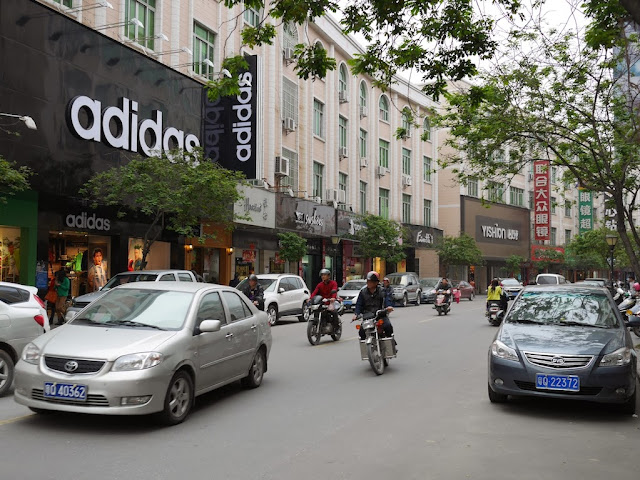 street with adidas store in Yangjiang, China