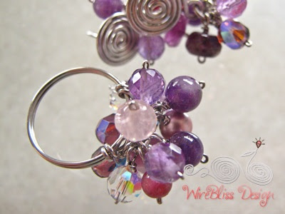 Wire wrapped Cluster Ring with mixture of purple or near purple gemstones and crystals