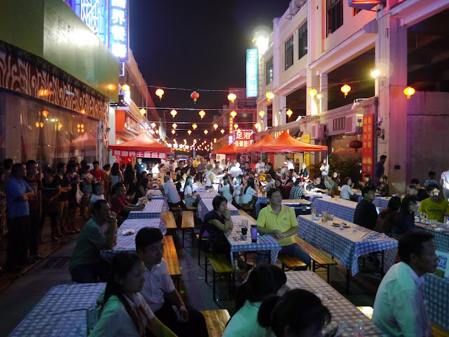 crowd at picnic tables for Zhuhai's October Beer Street Festival