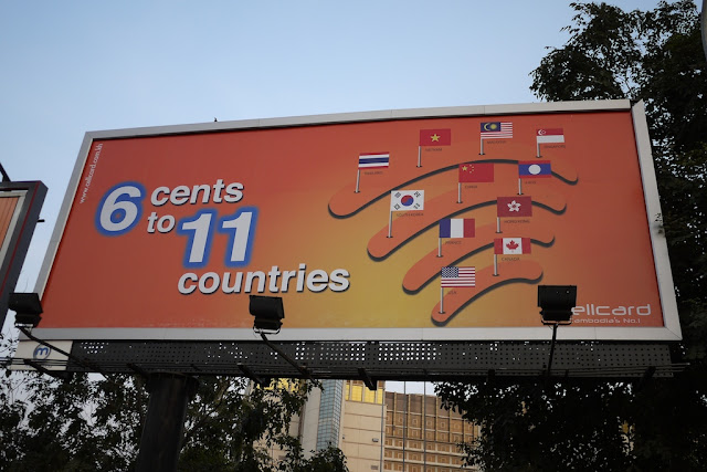 "billboard reading ""6 cents to 11 countries"" with images of flags from 10 countries and Hong Kong"