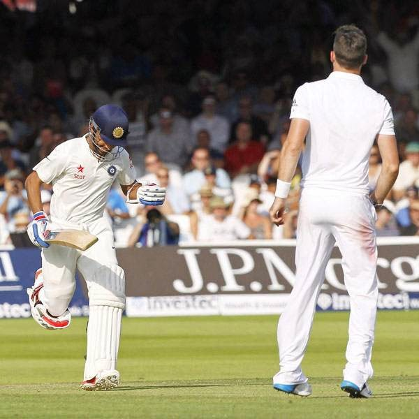 India's Ajinkya Rahane (L) reacts as he runs to make his century off the bowling of England's James Anderson during the first day of the second cricket Test match between England and India at Lord's cricket ground in London on July 17, 2014.