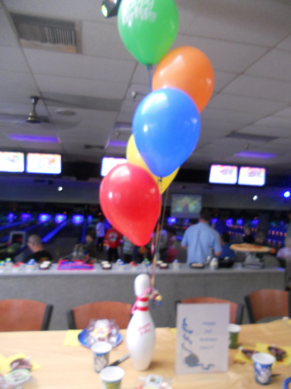 Bowling pin balloons - Pretty Balloons Tied To A Bowling Pin The