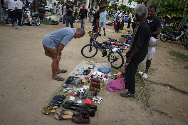 various items for sale at an outdoor market in George Town, Penang, Malaysia