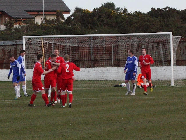 Lossie celebrate going two goals ahead thanks to Liam Archibald (somewhere in the middle)