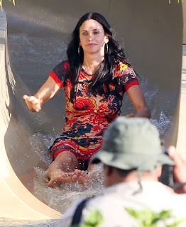 Courteney Cox doing Water Slide