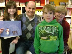 The Divine Miss M and Li'l Man with their bedtime story creators, Mark and Caralynn Buehner