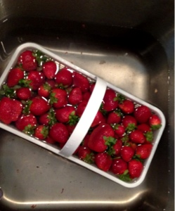 An over head picture of a basket of strawberries
