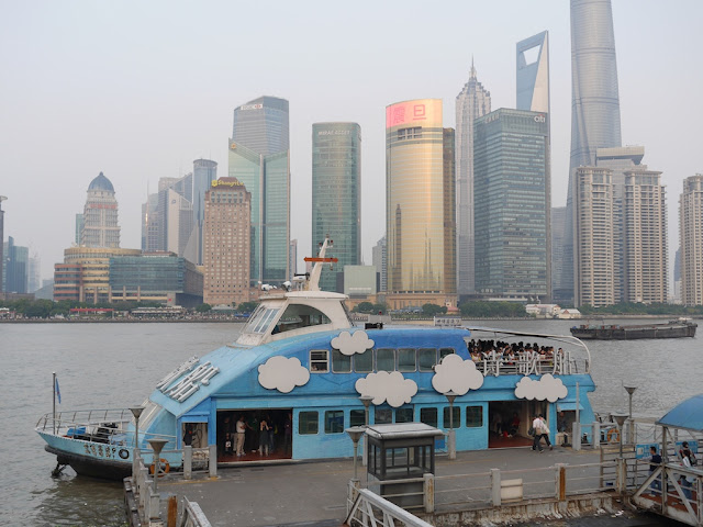 ferry boat with a cloud and sky design in Shanghai