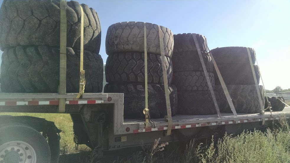 flatbed loaded with old truck tires