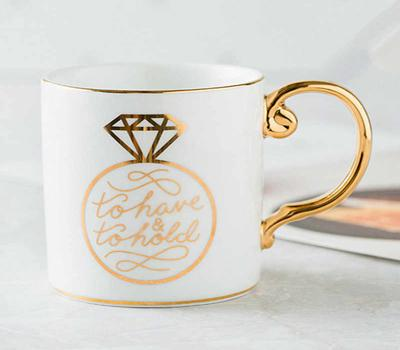 A picture containing cup, coffee, tableware, coffee cup  Description automatically generated