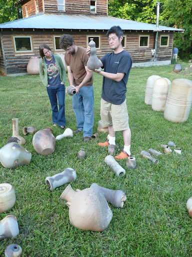 Potters inspect their work.