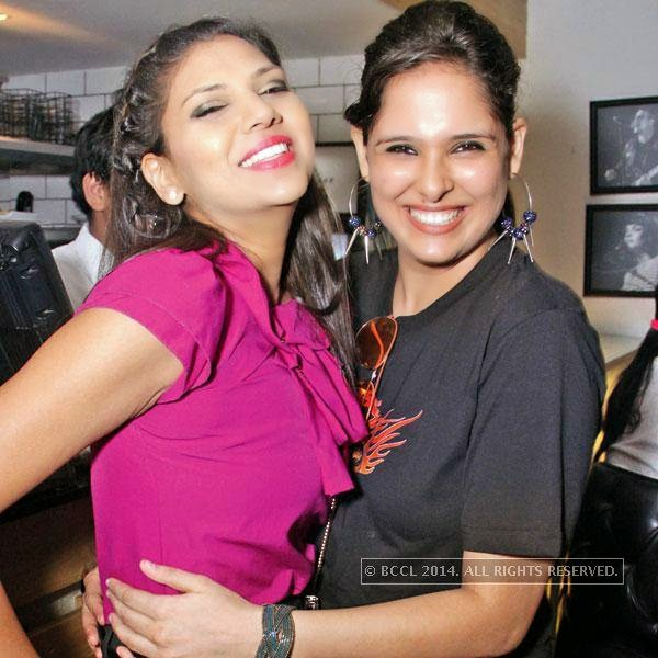 Aditi (L) and Parmeet during bikers' night at AMPM Cafe & Bar, in Delhi.