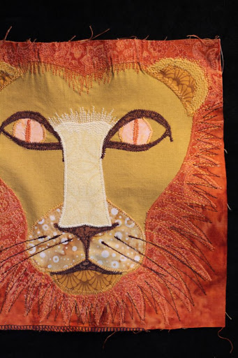 applique'd and embroidered lion's head