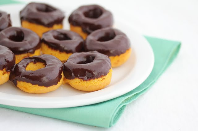 close-up photo of a plate of mini donuts on a plate