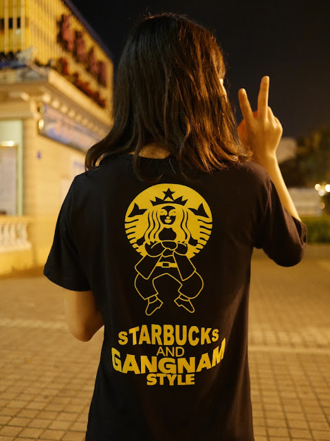 back of a t-shirt with a Gangnam Style Starbucks logo