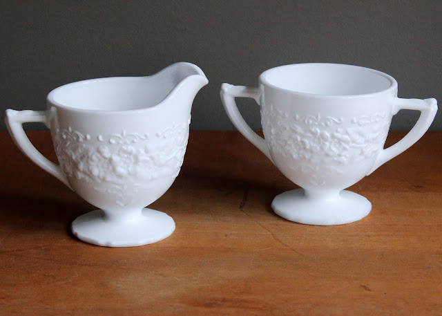 Milk glass creamer & sugar set available for rent from www.momentarilyyours.com, $2 for the set.