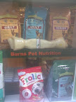 pet shop display with large chew bone & bags of dry food