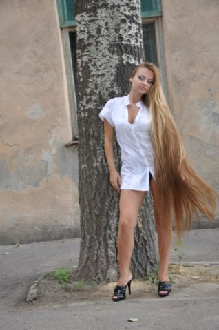 Long hair photo Young pretty woman with beautiful long blond hairs