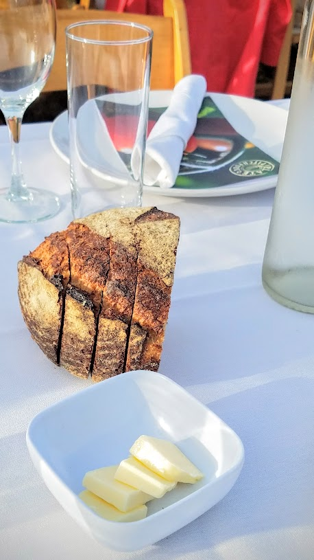 Plate and Pitchfork, bringing farm to table dinners during the summer in Portland where guests dine al fresco on farms. Grand Central Bakery bread was at each end of the table for 8.