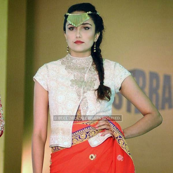 Virajah showcases a creation during Year End Expo fashion show, held at hotel Breeze.