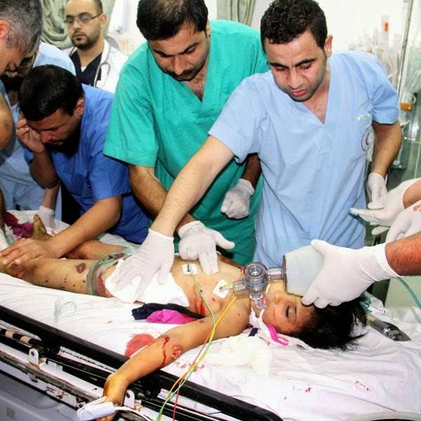 Palestinian doctors treat Sara Sheikh el-Eid, a 9-year-old Palestinian girl who was wounded in an Israeli air strike on her family house, at the Najar hospital in Rafah, southern Gaza Strip.