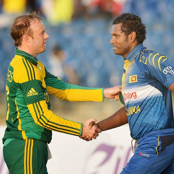 South African captain AB de Villiers (L) shakes hands with Sri Lankan captain Angelo Mathews (R) after winning the third and final One Day International (ODI) cricket match between South Africa and Sri Lanka at the Mahinda Rajapaksa International Cricket Stadium in Hambantota on July 12, 2014.