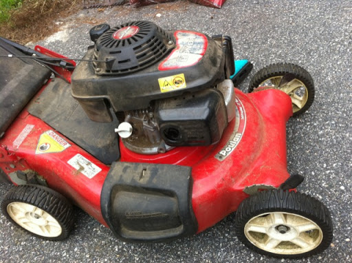gas leak from muffler and air cleaner filter box - honda mower
