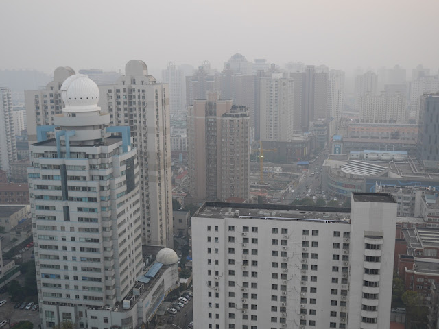 View of buildings and air pollution from the 35th story of a building in Xujiahui, Shanghai.