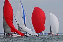 J/111s sailing SPI Ouest France gybing for finish line