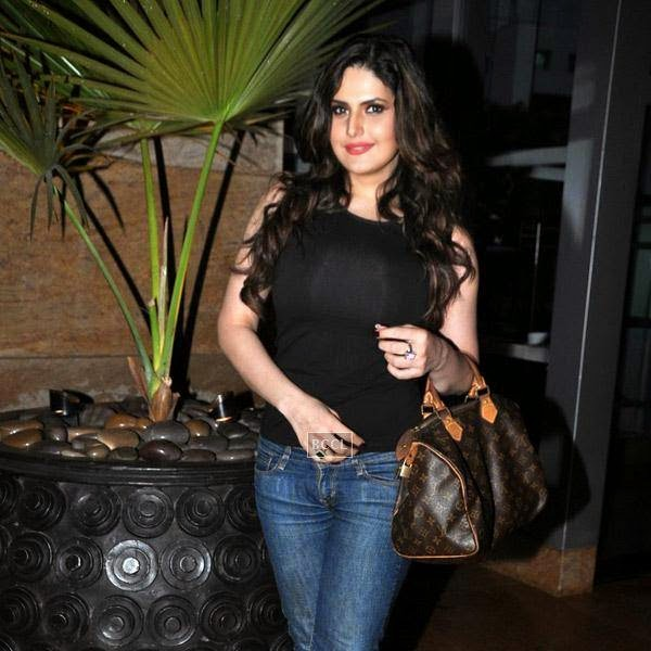 Bollywood actress Zarine Khan snapped enjoying a stroll in Mumbai, on July 16, 2014.(Pic: Viral Bhayani)