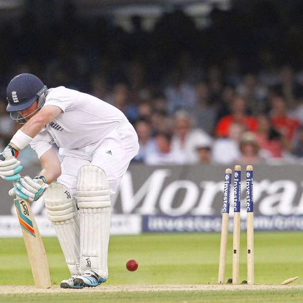 England's Ian Bell is bowled by India's Ishant Sharma (not pictured) for 1 run during play on the fourth day of the second cricket Test match between England and India at Lord's cricket ground in London on July 20, 2014.
