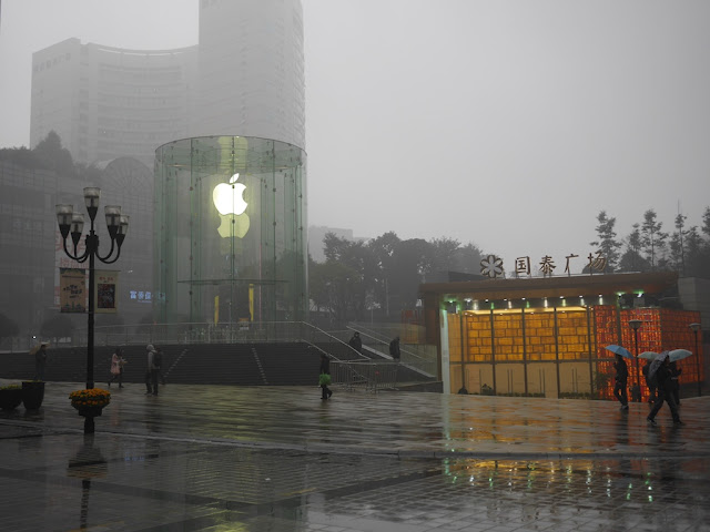 entrance to Jiefangbei Apple Store in Chongqing on a drizzly afternoon