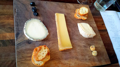A cheese board at Chizu that includes Veigadarte, a goat cheese from Spain; Beaufort D'été, a raw cow cheese from France; Cowgirl Creamery's Red Hawk cow cheese from California