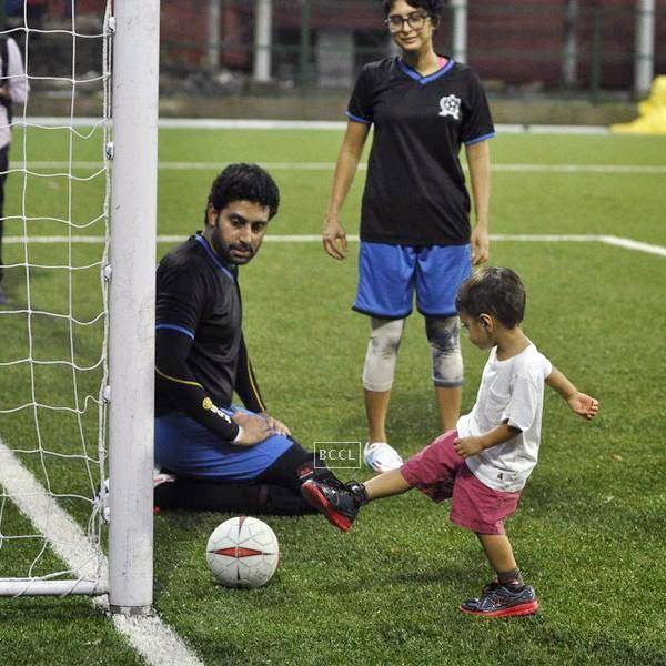Azaad Khan plays soccer as Abhishek Bachchan and Kiran Rao look on during a charity soccer match organised by Ira Khan, at Cooperage ground, on July 20, 2014.(Pic: Viral Bhayani)