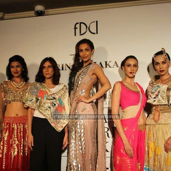 Nimrat Kaur, Rina Dhaka and Malaika Arora Khan during the India Couture Week, 2014, held at Taj Palace, in New Delhi.