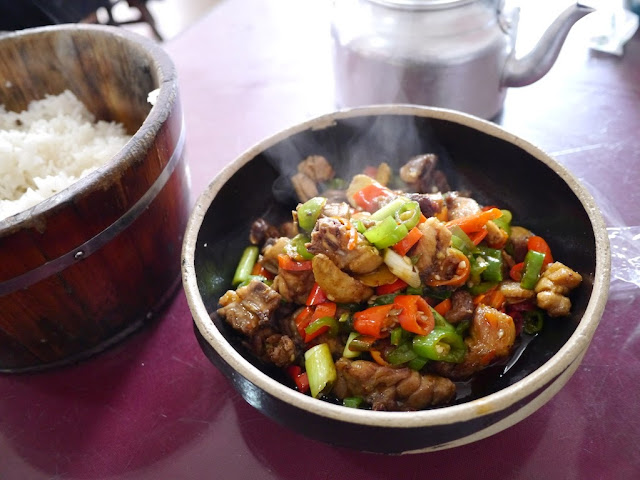 spicy chicken dish, rich, and a pot of tea at a restaurant in Changsha, China