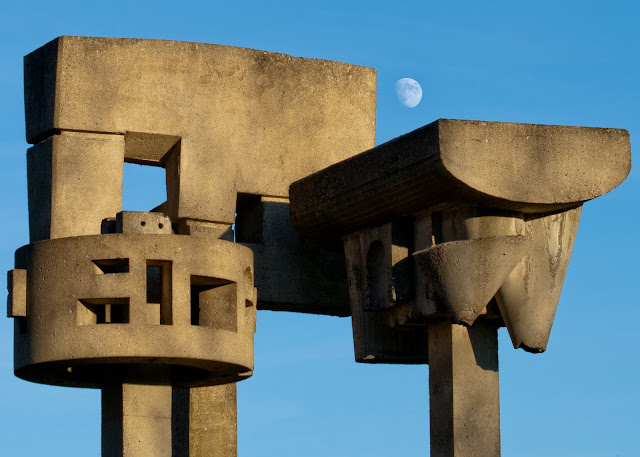 Moon over sculpture