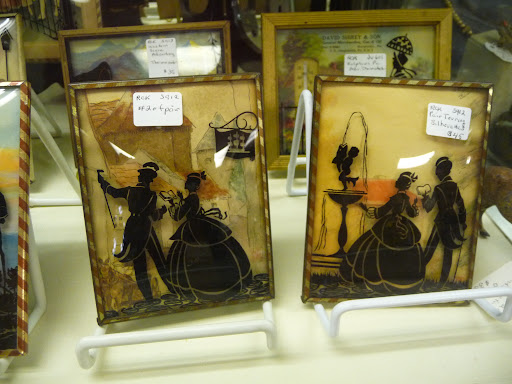The silhouettes appear to be painted on the inside of the frame.