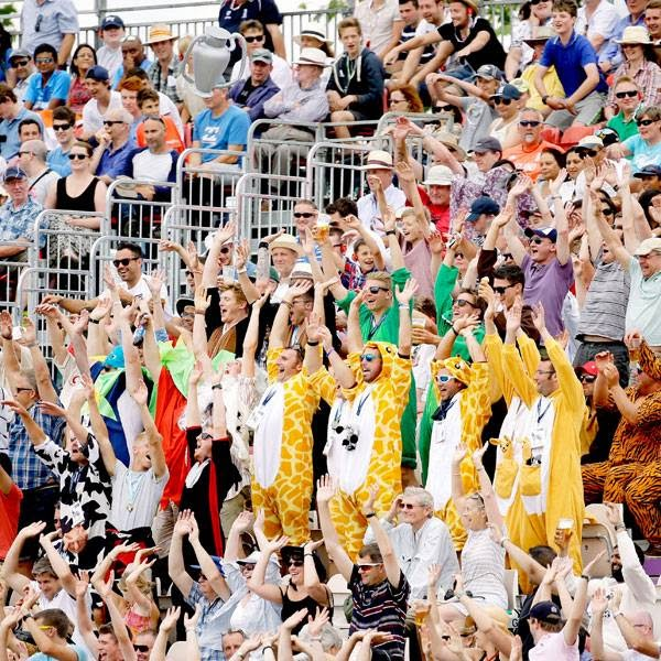 Fans take part in a Mexican wave during the first day of the third cricket test match of the series between England and India at The Ageas Bowl in Southampton, England, Sunday, July 27, 2014.