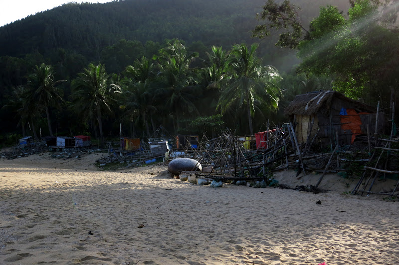 fishing gear and boats on the beach