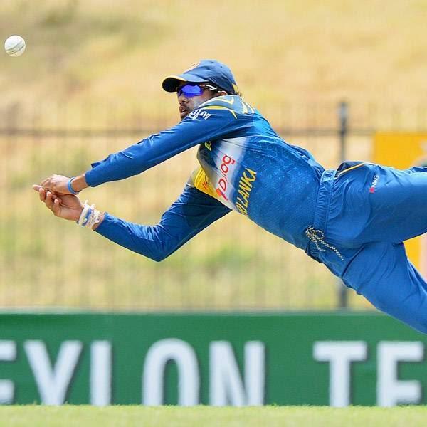 Sri Lankan cricketer Sachithra Senanayake stops the ball during the third and final One Day International (ODI) cricket match between South Africa and Sri Lanka at the Mahinda Rajapaksa International Cricket Stadium in Hambantota on July 12, 2014.