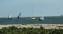 J/105 one-design sailboats- sailing in a gale off Santa Barbara, CA