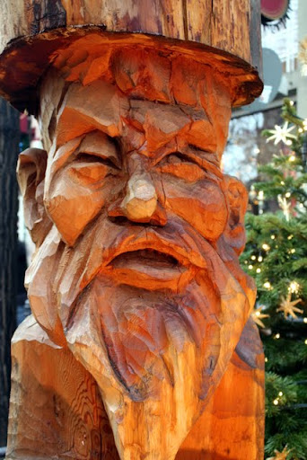 Wood carving of a gnome at the Christmas Market in the old town in Cologne Germany