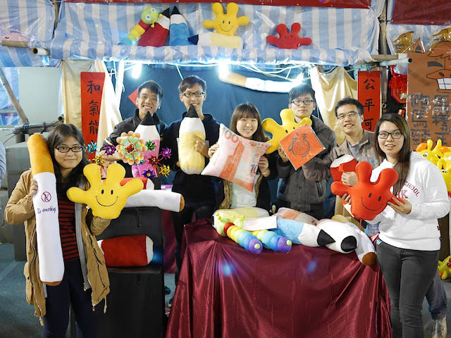 seven college students holding stuffed toys