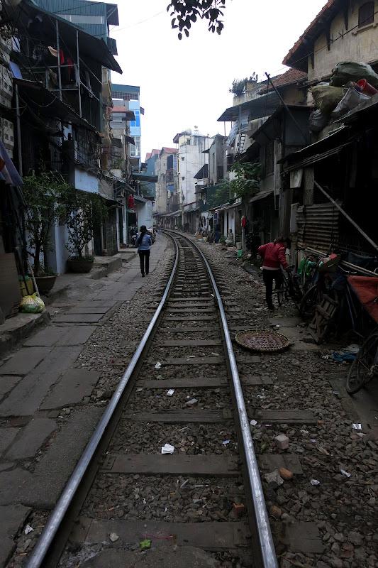 Train tracks through a neighborhood