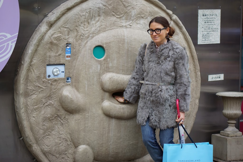 grey mouton coat with jeans and statement earrings