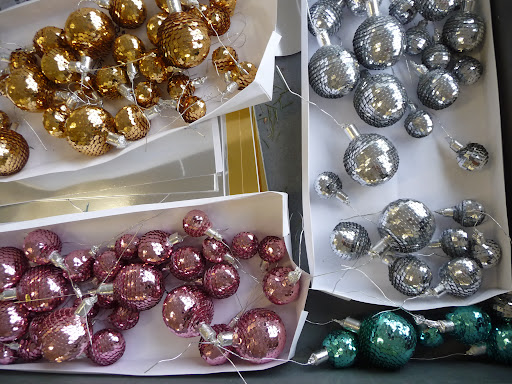 These glass ball picks were wrapped with strands of sequins to adorn the glam wreath behind Martha.